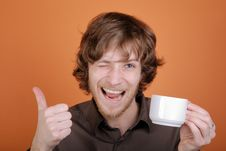 The Man With A Cup In A Hand Royalty Free Stock Photography