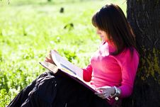 Enjoying A Book In The Forest Royalty Free Stock Image