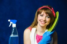 Young Housewife Washing The Dishes Royalty Free Stock Images