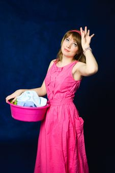 Free Tired Housewife With A Basin Full Of Clothes Royalty Free Stock Photos - 8176328
