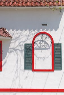 Free A Red Arch With Green Shutters Royalty Free Stock Photography - 8176687