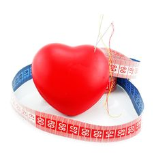 Heart Shaped Pincushion And Measuring Tape Royalty Free Stock Images
