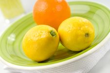 Free Orange And Lemons On Green Plate Stock Images - 8179934