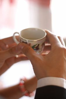 Hand Holding Chinese Wedding Cup Stock Image