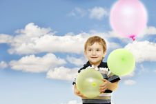 Happy Boy With Colorful Balloons Stock Photo