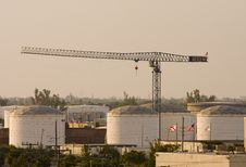 Free Crane Over Tanks On Grey Day Stock Photography - 8187692