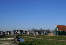 Fence And View With Typical  Dutch Zaanse Houses Royalty Free Stock Image