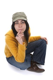 Young Casual Woman With Hat And Yellow Sweater Stock Image