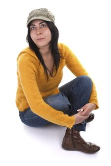Young Casual Woman With Hat And Yellow Sweater Royalty Free Stock Photo