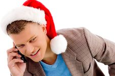 Free Man With Christmas Hat Talking On Mobile Royalty Free Stock Photo - 8196965