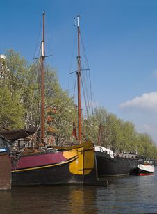 Yachts In City Canal, Amsterdam, Netherlands Stock Photo