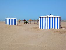 Two Beach Cabins And Umbrellas Royalty Free Stock Image