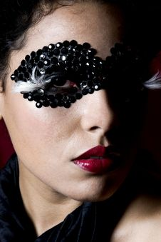 Free Attractive Young Woman Wearing A Black Gem Mask Stock Photo - 829860