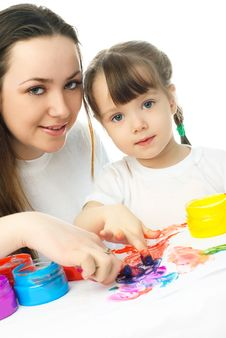 Mother And Daughter Painting With Finger Paints Royalty Free Stock Photos