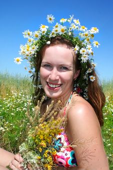 Beautiful Girl In The Wreath Of Daisies Stock Photo