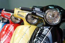 Three Scooters, Black, Yellow And Red Stock Images
