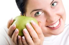 Beautiful Young Woman Holding An Apple Royalty Free Stock Photos