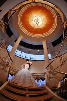 Free Bride On Stairs With Large Chandelier Over Her Stock Photo - 8207440
