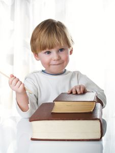 Free The Boy With Books Stock Image - 8208491