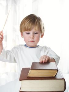 Free The Boy With Books Stock Image - 8208601