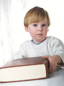 The Boy With The Book Stock Photo