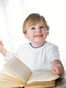 The Boy With The Book Royalty Free Stock Images