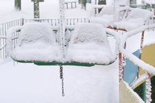 Free Winter Scene With Snowy Chairs Royalty Free Stock Photo - 8208935