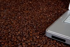 Laptop On Coffee Beans Stock Photo