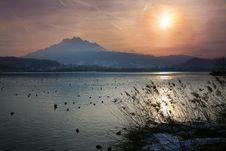 Free Winter Sun Over A Alpine Lake Stock Image - 8209751