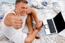 Free Young Man With Thumbs Up And Laptop Stock Image - 8211181