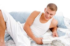 Free Young Man Reading Book In Bed Stock Image - 8211301