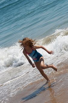 Free Happy Little Girl Running On The Beach Stock Image - 8211811