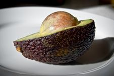 Free Avocado Seed Exposed. Royalty Free Stock Photography - 8215327