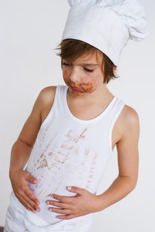 Free Young Baker Boy Eating Chocolate Royalty Free Stock Images - 8218909
