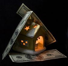 The Small House Covered By Dollars Stock Images