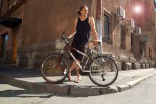 Free Smiling Young Man With The Bike Stock Photography - 8219082
