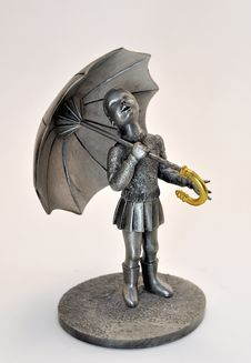 Pewter Little Girl Statue With Umbrella Stock Image