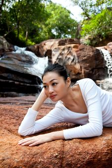 Young Woman Relaxing By The Waterfall Royalty Free Stock Photos