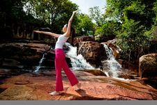 Young Woman Relaxing At The Waterfall Royalty Free Stock Photos