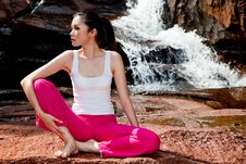 Young Woman Relaxing At The Waterfall Royalty Free Stock Photography