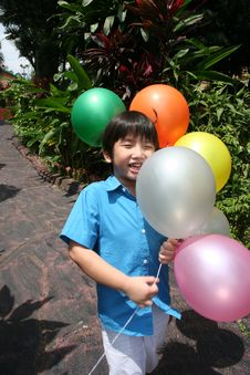 Free Boy Holding Balloons Stock Image - 8229571