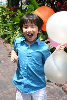Free Happy Boy Holding Balloons Royalty Free Stock Photo - 8229625