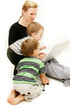 Mother With 2 Children And Laptop