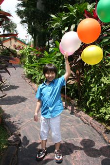 Free Boy Holding Balloons Stock Images - 8229944
