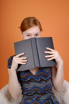 Free Woman Hides The Face Behind The Book Royalty Free Stock Photos - 8231248