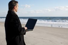 Businessman On The Beach Royalty Free Stock Photos
