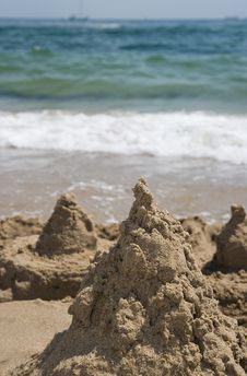 Free Sand Mountains Against The Sea Royalty Free Stock Image - 8232866