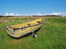 Free Small Skiff Boat On The Seashore Field Stock Photography - 8233402