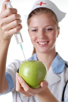 Nurse With Syringe And Apple Royalty Free Stock Photos