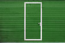 Simple Door In Colored Wall Royalty Free Stock Images